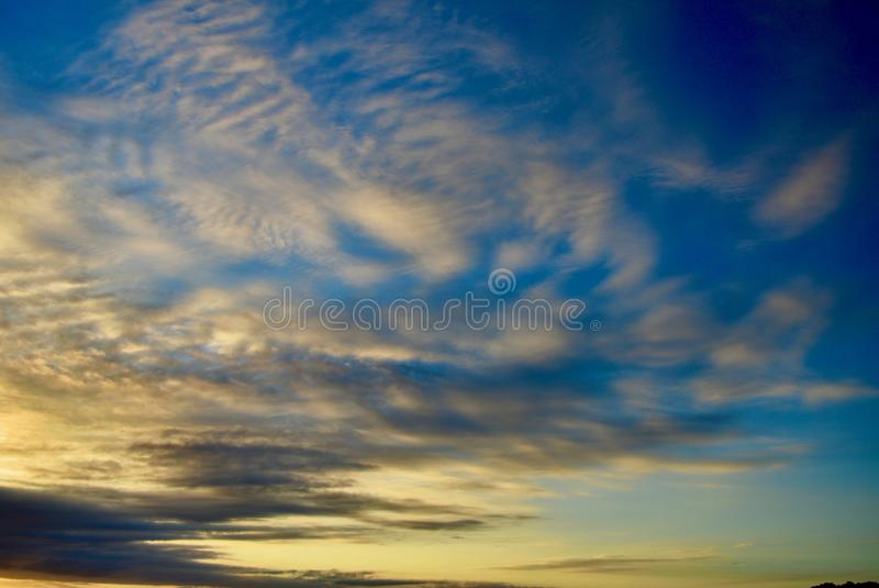 Dramatic evening sky with magnificent cloud formations. Beautiful colours of approaching night. Beautiful colours of approaching night; sky and sea in the stock photos