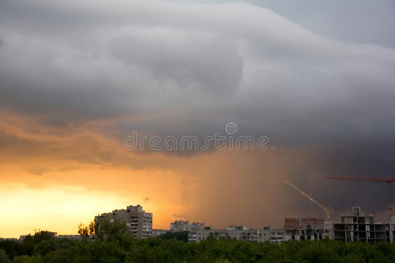 Dramatic fiery stormy sky in a mixture of yellow, orange, gray and black colors.  royalty free stock image