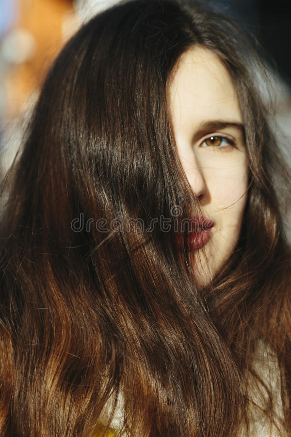 Dramatic fine art portrait of a girl theme. Beautiful lonely girl with flying hair in the wind. royalty free stock photography