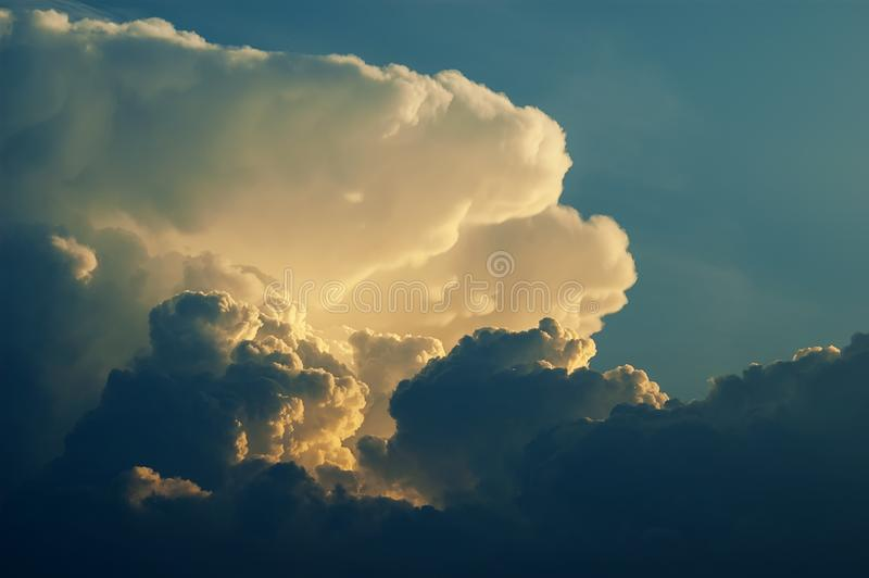 Dramatic formation of cumulonimbus clouds rising in blue sky royalty free stock photo