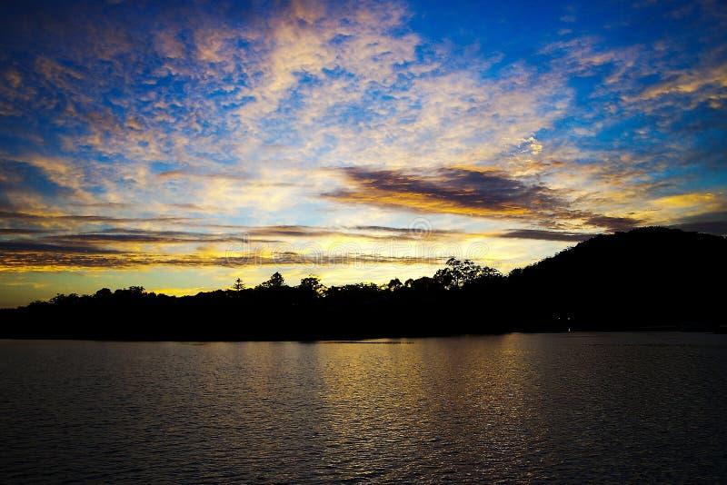 Dramatic gold blue sunrise seascape. royalty free stock images