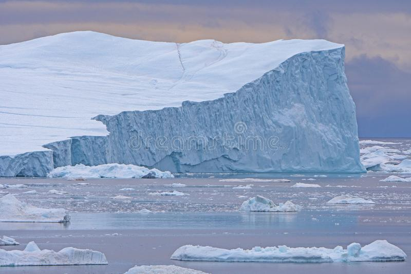 Dramatic Iceberg in Evening Light. By the Icefjord of Ilulissat, Greenland royalty free stock photo