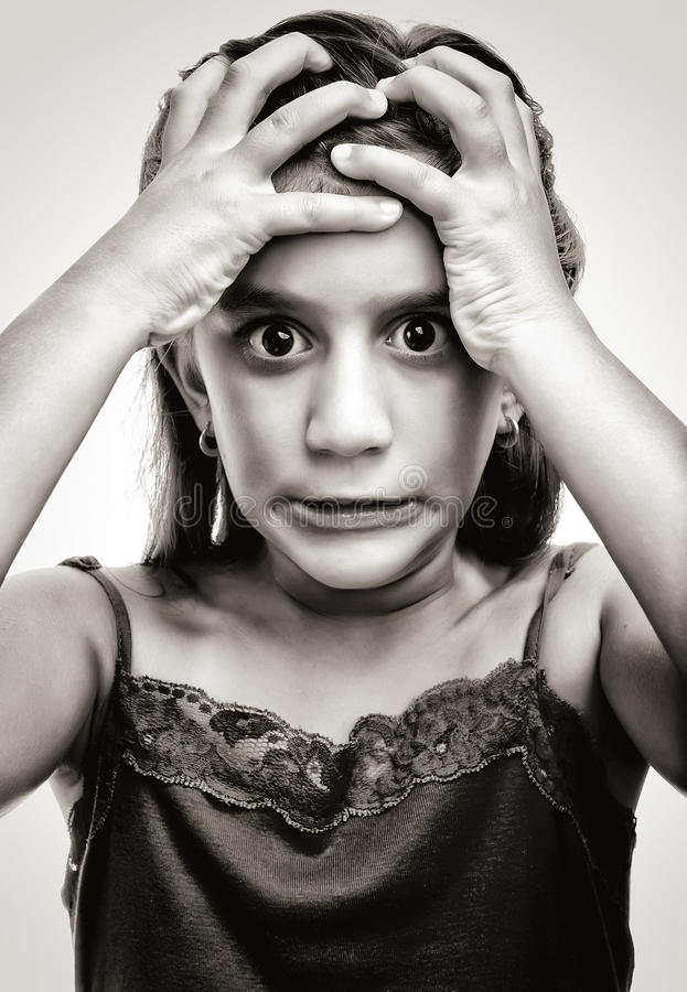 Dramatic image of a latin girl with an angry face stock images