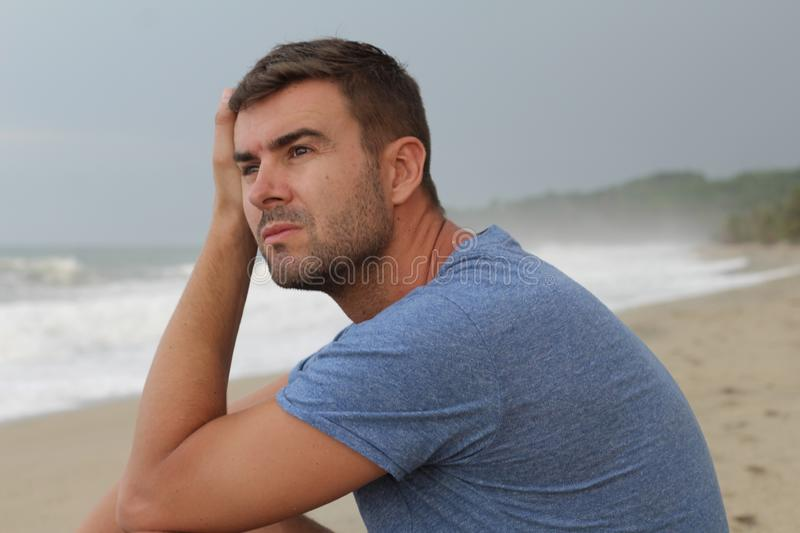 Dramatic image of pensive man at the beach stock photography