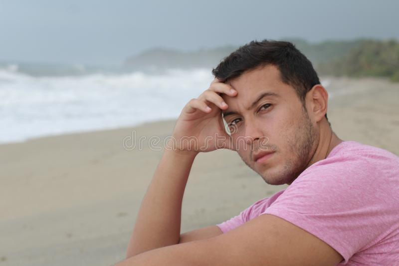 Dramatic image of pensive man at the beach royalty free stock photography