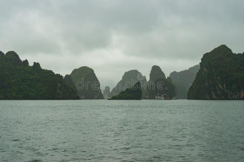 Dramatic karst islands of Halong Bay on mist stock photos
