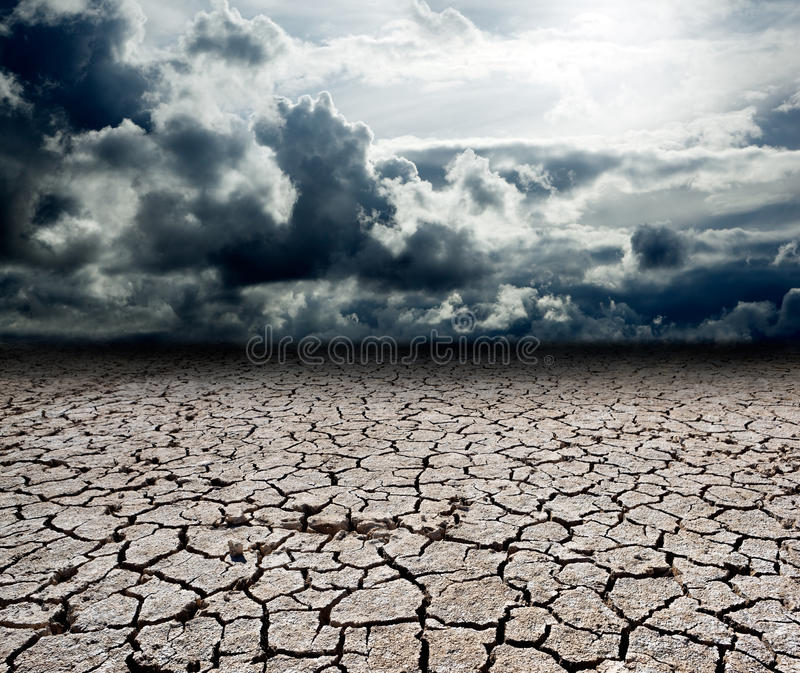 Dramatic landscape. Landscape with storm clouds and dry soil royalty free stock image
