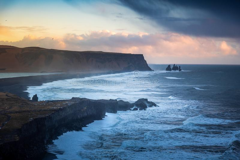 Dramatic landscape of Black Sand Reynisfjara beach in Iceland. On a cloudy day, lanscape, sunset, scenic, icelandic, tourist, vik, stunning, nobody, sky stock photos