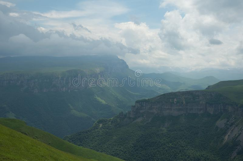 Dramatic landscape of a green valley at the foot of the Inal Plateau in the North Caucasus.  stock photos