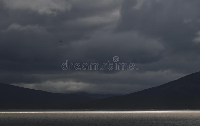Dramatic landscape line of sunlight on the lake, Sarek, Sweden royalty free stock images