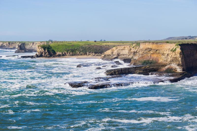 Dramatic landscape of the Pacific Ocean Coast during high tide and strong surf, Wilder Ranch State Park, California royalty free stock photography