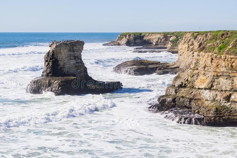 Dramatic landscape of the Pacific Ocean Coast during high tide and strong surf, Wilder Ranch State Park, California royalty free stock image
