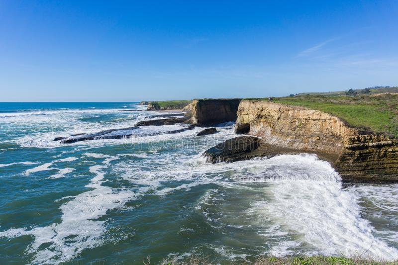 Dramatic landscape of the Pacific Ocean Coast during high tide and strong surf, Wilder Ranch State Park, California stock photo