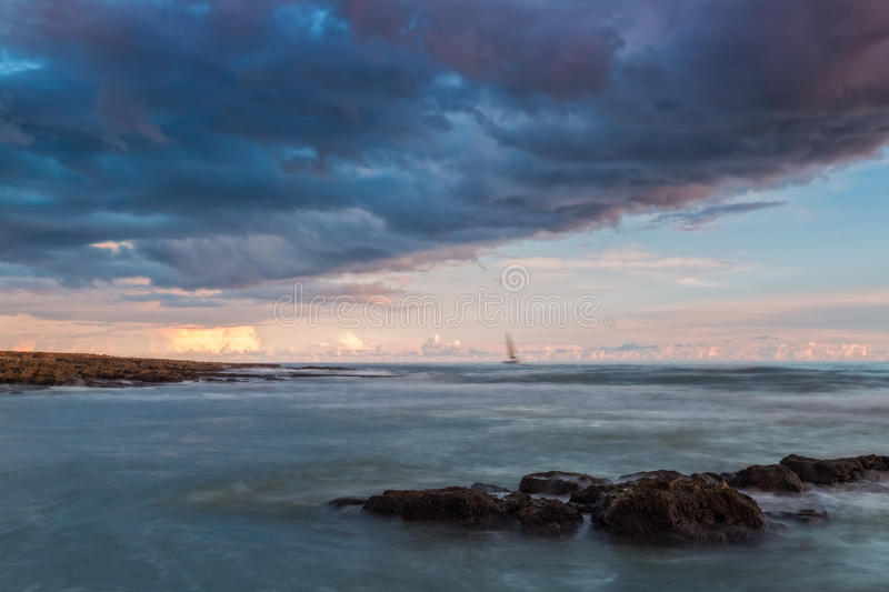 Dramatic landscape sailboat before the storm. stock photo