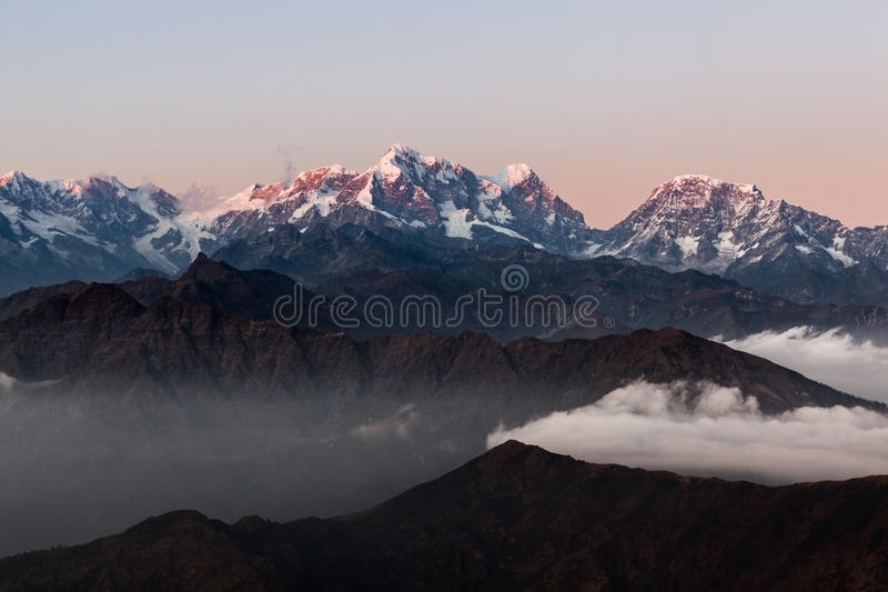 Dramatic landscape with snowy peaks rising above. royalty free stock photos