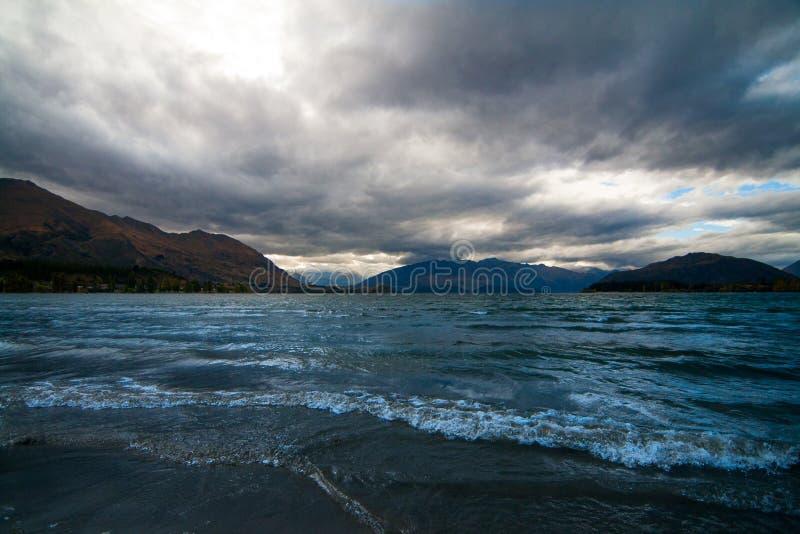 Dramatic landscape of tumultuous lake Wakatipu with hills of Central Otago, New Zealand stock images