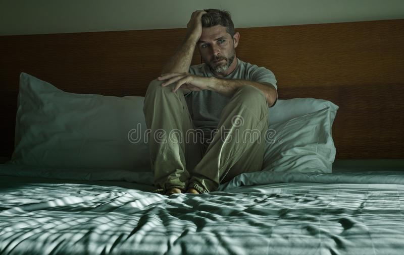 Dramatic lifestyle portrait of 30s to 40s handsome man sitting s royalty free stock photography