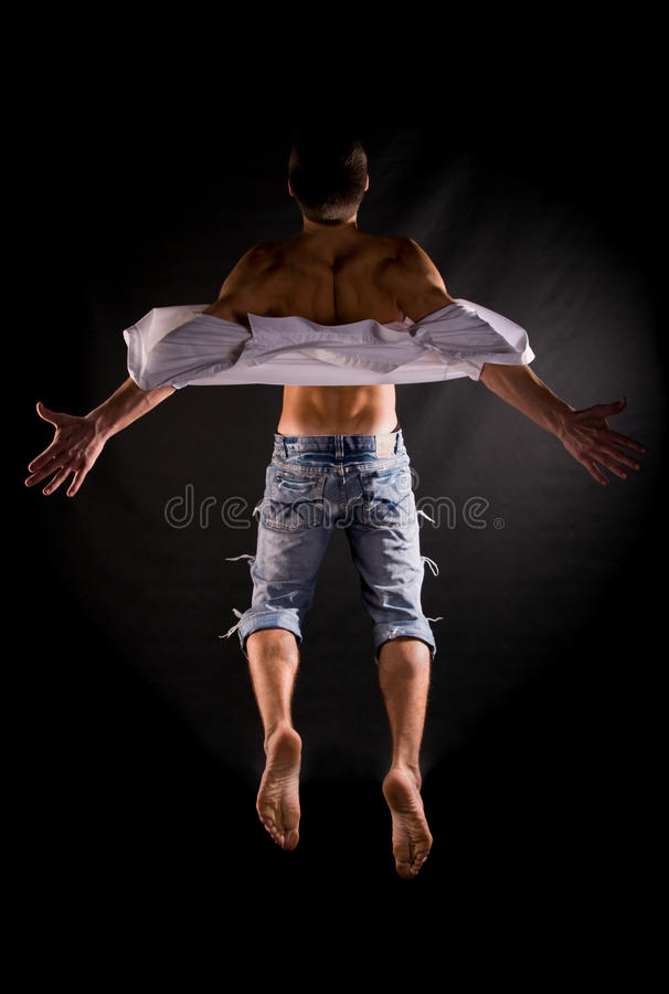 Dramatic light photo of modern acrobat stock image