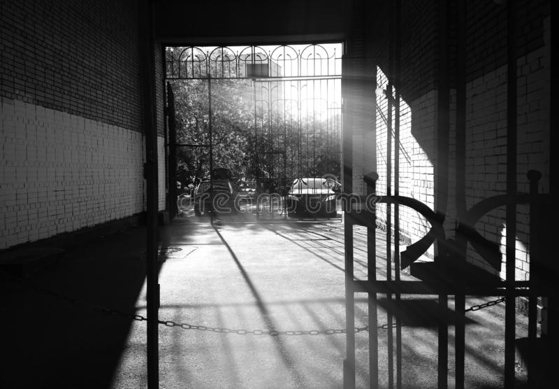 Dramatic light rays at Moscow suburbs yard background. Horizontal orientation vivid vibrant black white bright rich composition design concept element object stock photo
