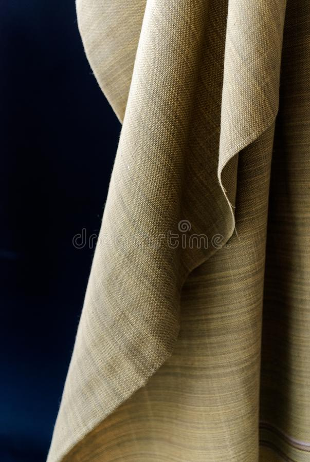 Dramatic light and shadow of organic dyed contton fabric in earth tone color , Thailand stock photography