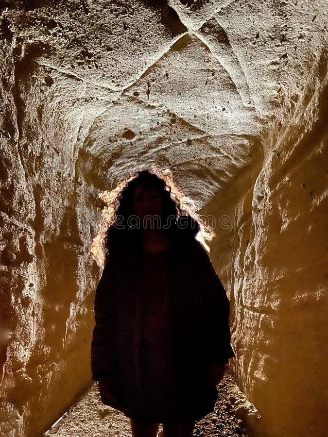 Woman in a cave stock photo