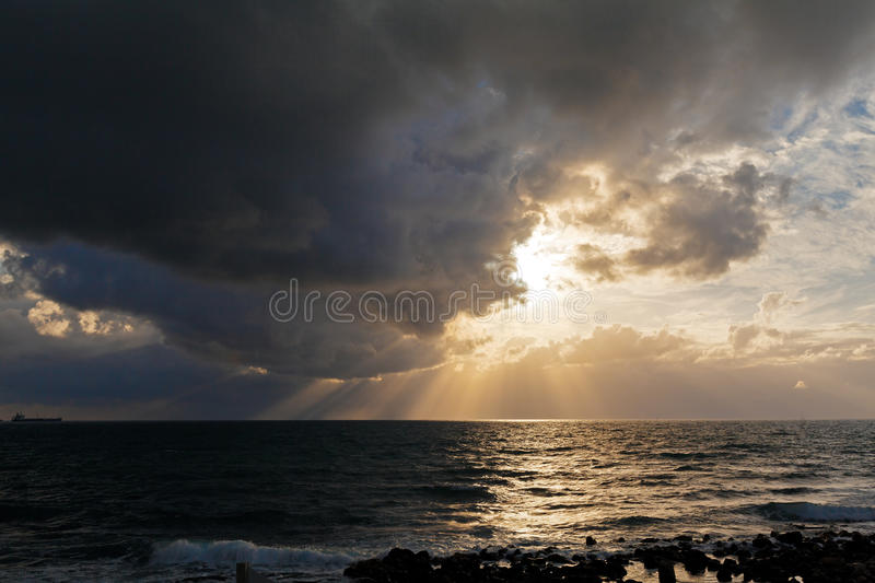 Dramatic Light with Sun Rays and Heavy Clouds. Above Mediterranean Sea near Caesarea Maritima, Israel royalty free stock image