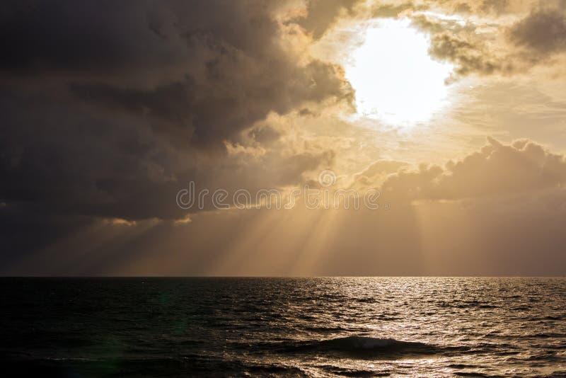 Dramatic Light with Sun Rays and Heavy Clouds. Above Mediterranean Sea near Caesarea Maritima, Israel stock photo
