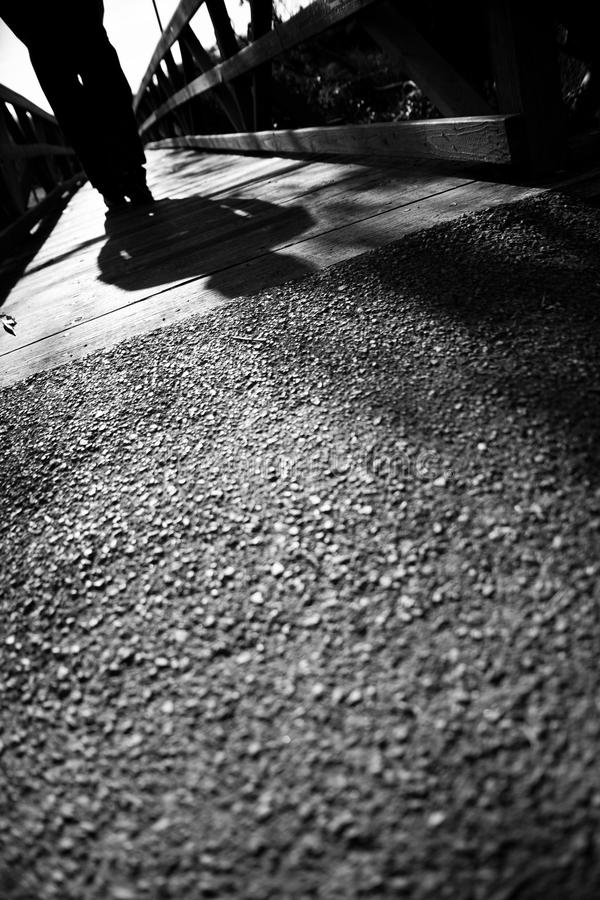 Free Dramatic Man Crossing A Bridge Royalty Free Stock Images - 62132729