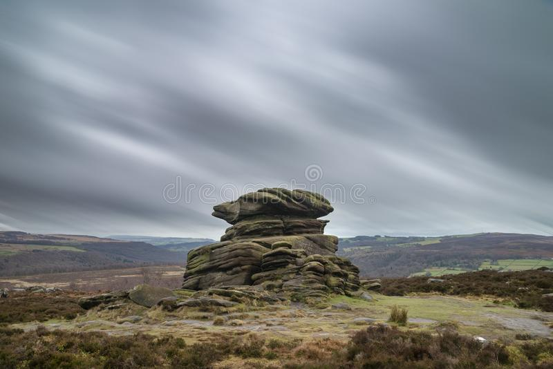 Dramatic moody Winter landscape image of Peak District in England during soft afternoon light. Beautiful moody Winter landscape image of Peak District in England stock images