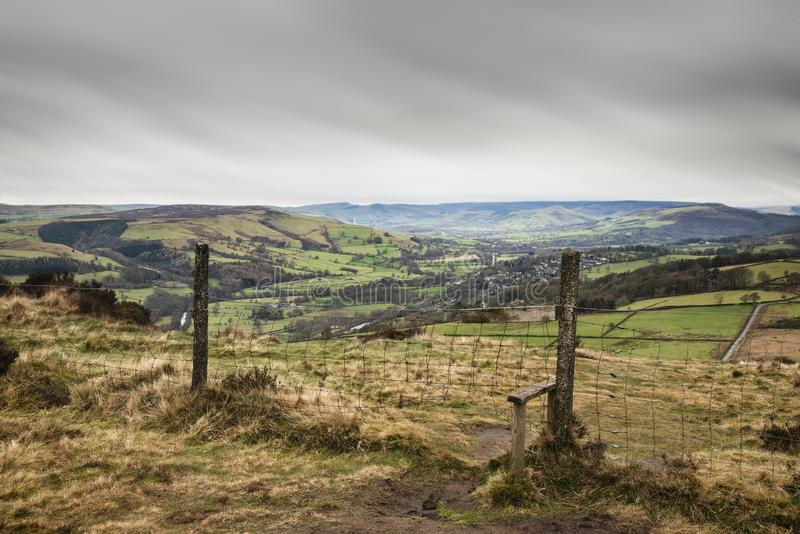 Dramatic moody Winter landscape image of Peak District in England during soft afternoon light. Beautiful moody Winter landscape image of Peak District in England royalty free stock photo