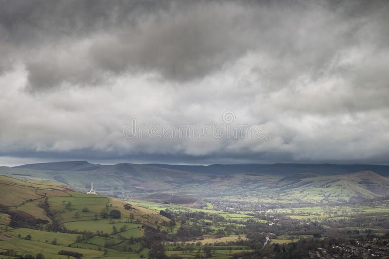 Dramatic moody Winter landscape image of Peak District in England during soft afternoon light. Beautiful moody Winter landscape image of Peak District in England stock photography