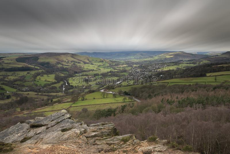 Dramatic moody Winter landscape image of Peak District in England during soft afternoon light. Beautiful moody Winter landscape image of Peak District in England royalty free stock photography