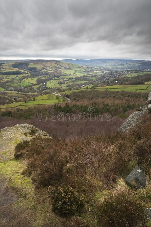 Dramatic moody Winter landscape image of Peak District in England during soft afternoon light. Beautiful moody Winter landscape image of Peak District in England royalty free stock images