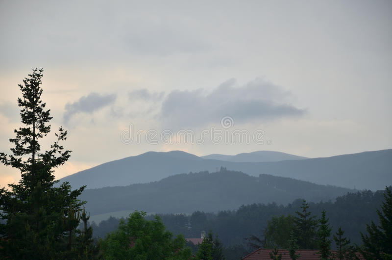 Dramatic Mountain Landscape. Grey sky with clouds over mountain hills bringing stormy weather in late afternoon stock images