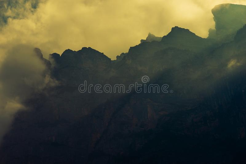Dramatic Mountain Vista. Granite Peaks Covered by Stormy Clouds royalty free stock images