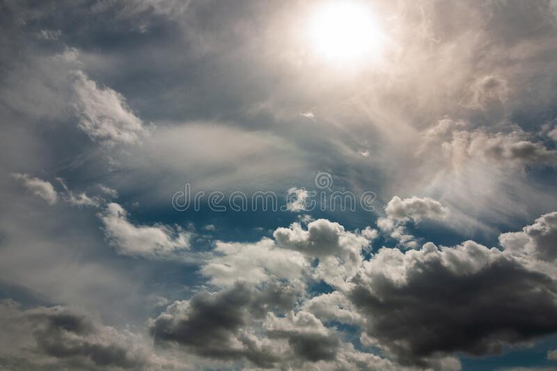 Dramatic mystical contrasting sky with thick gray clouds below and the sun above in a haze. artistic image for the original. Fairy dramatic mystical contrasting royalty free stock photos