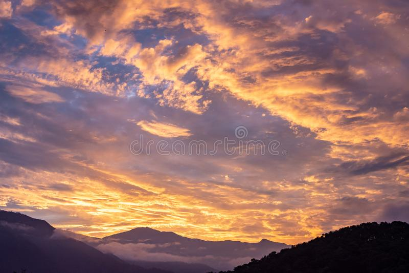 Dramatic orange cloudscape and sunset in Pokhara, Nepal stock images
