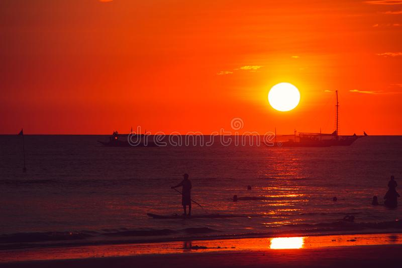 Dramatic orange sea sunset with boats. Summer time. Travel to Philippines. Luxury tropical vacation. Boracay paradise island. Seascape view. Tourism concept stock image
