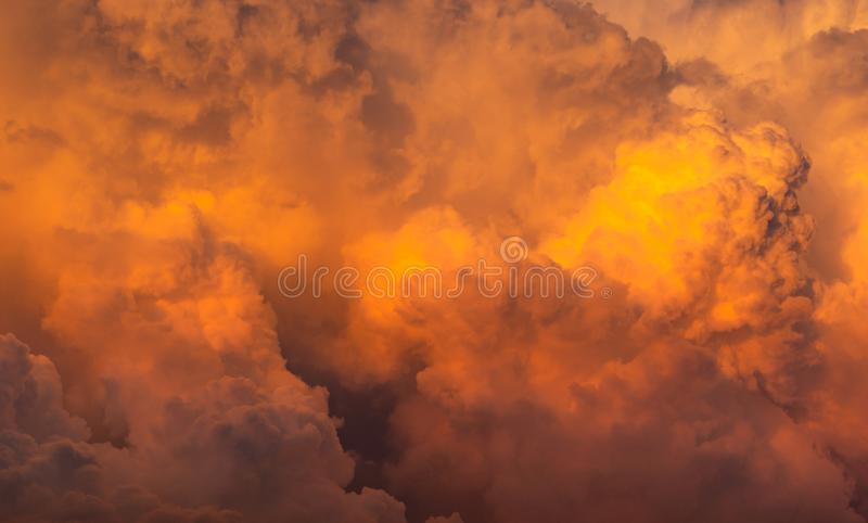 Dramatic orange sky and clouds abstract background. Top view of orange clouds. Warm weather background. Art picture of orange. Clouds texture royalty free stock image