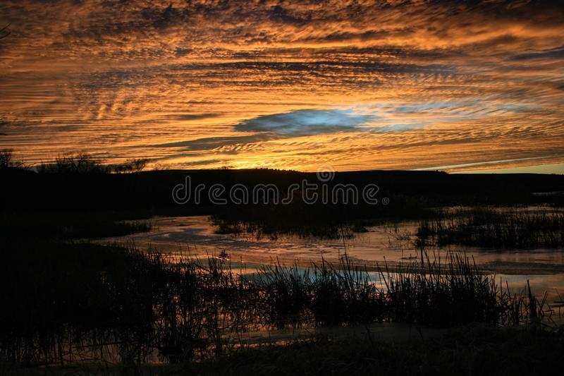 Dramatic orange sky. Sky turns orange as the sun begins to set royalty free stock photography