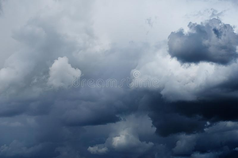 Dramatic overcast sky with dark dove-gray thunderclouds, royalty free stock photography
