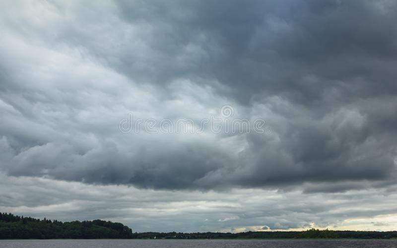 Dramatic Overcast Sky With Thunderclouds Over The Lake stock photography