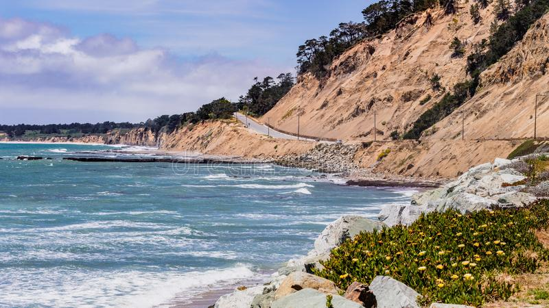 The dramatic Pacific Ocean coastline close to Santa Cruz, California; the scenic Highway 1 and eroded cliffs visible on the right stock image