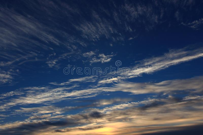 Amazing sky with clouds against the backdrop of dawn royalty free stock photo