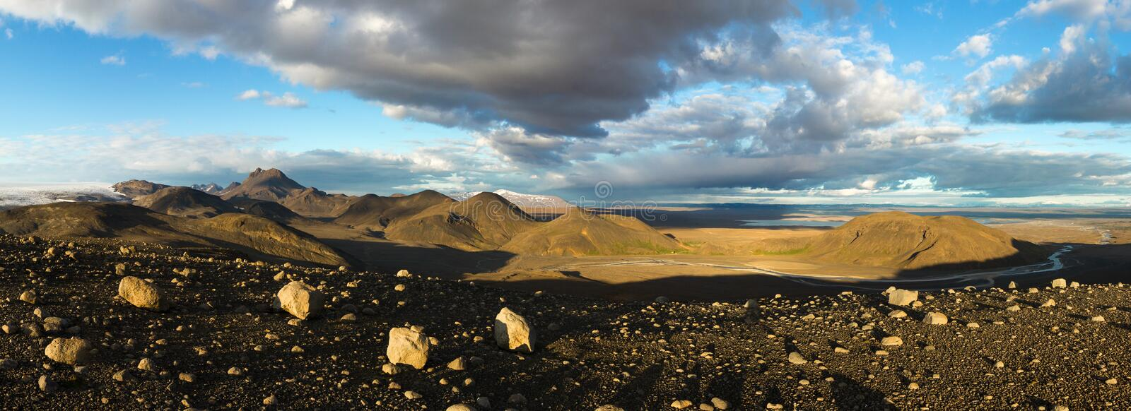 Illuminated panoramic landscape with mountains, glacier and lake in Iceland. Beautiful midnight sun scenery. stock images