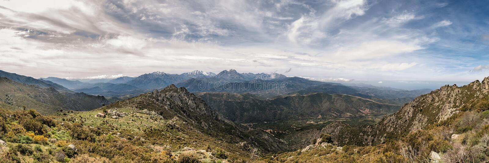 Dramatic panoramic view of snow capped mountains of northern Cor stock images