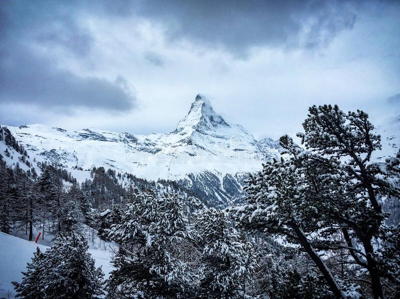 Dramatic picture of Matterhorn mountain in front of a cloudy sky royalty free stock image