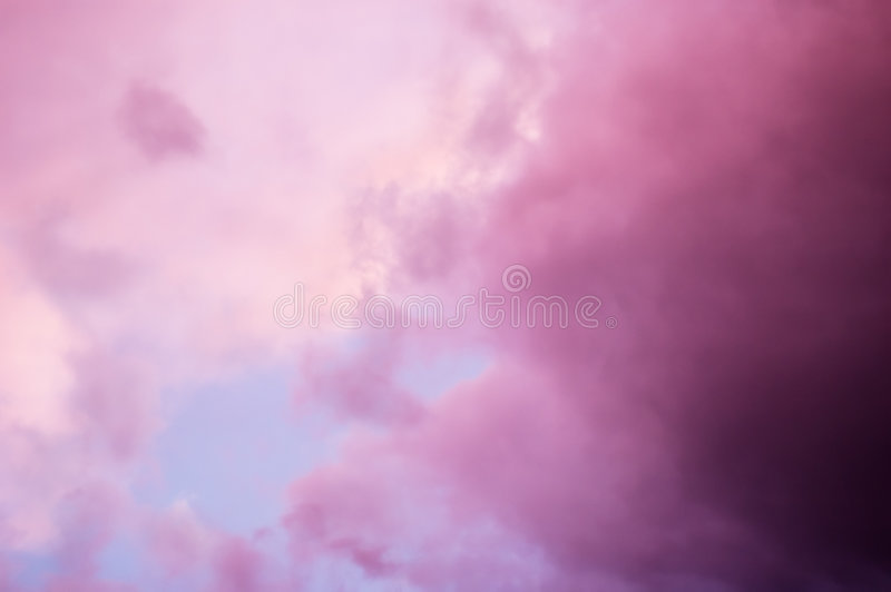 Dramatic pink clouds stock photo