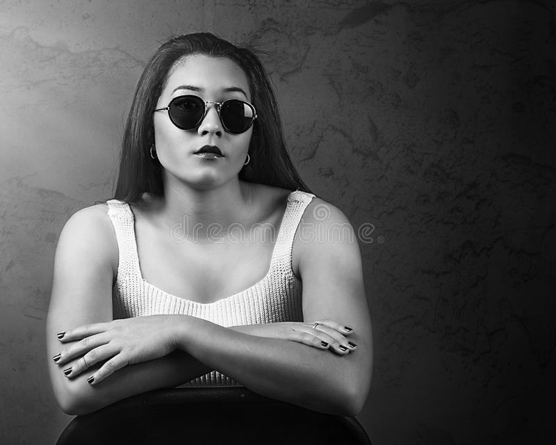 Dramatic portrait of beautiful Pacific Islander woman wearing sunglasses stock images