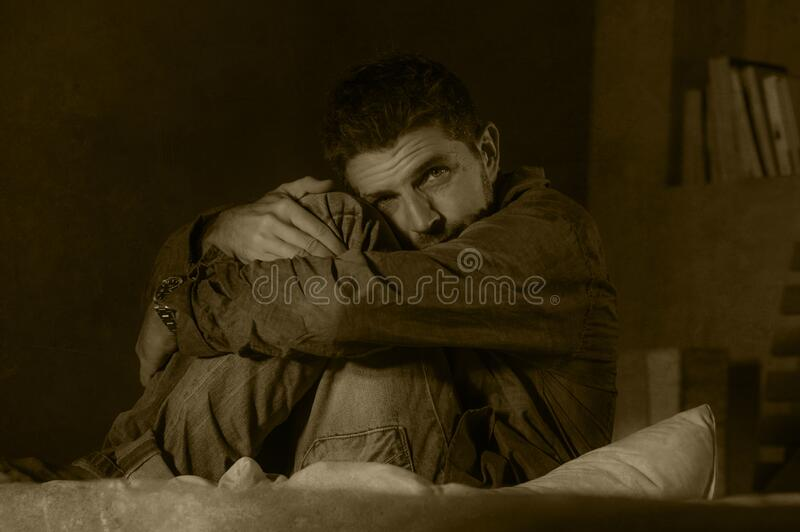 Dramatic portrait of depressed and sick man suffering from psychosis illness or mental disorder looking weird and helpless in royalty free stock photography
